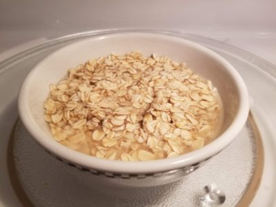 Bowl of oatmeal with water.